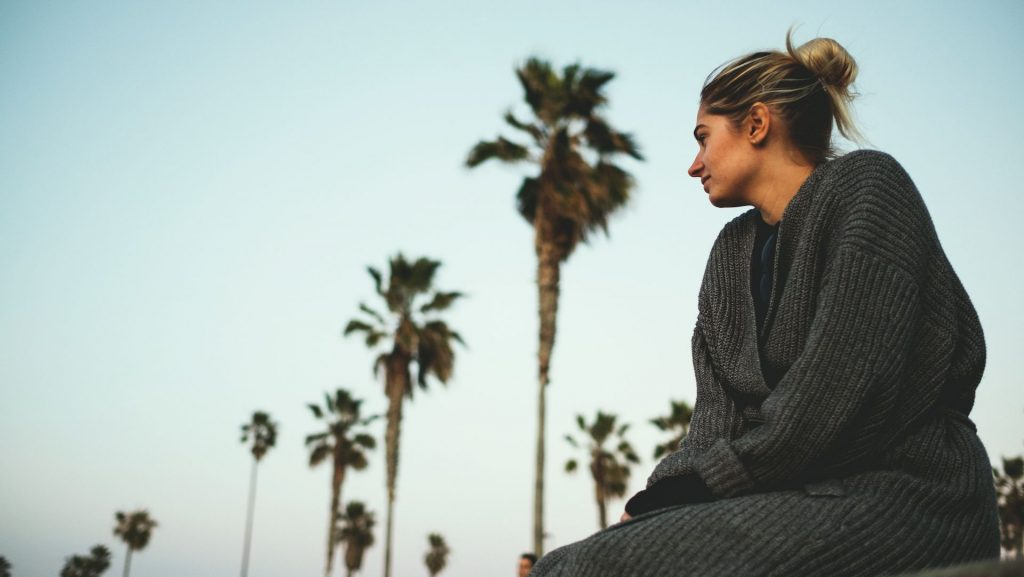 girl, lady, female, palm trees, jumper, blue skies, sunset, dusk, dawn