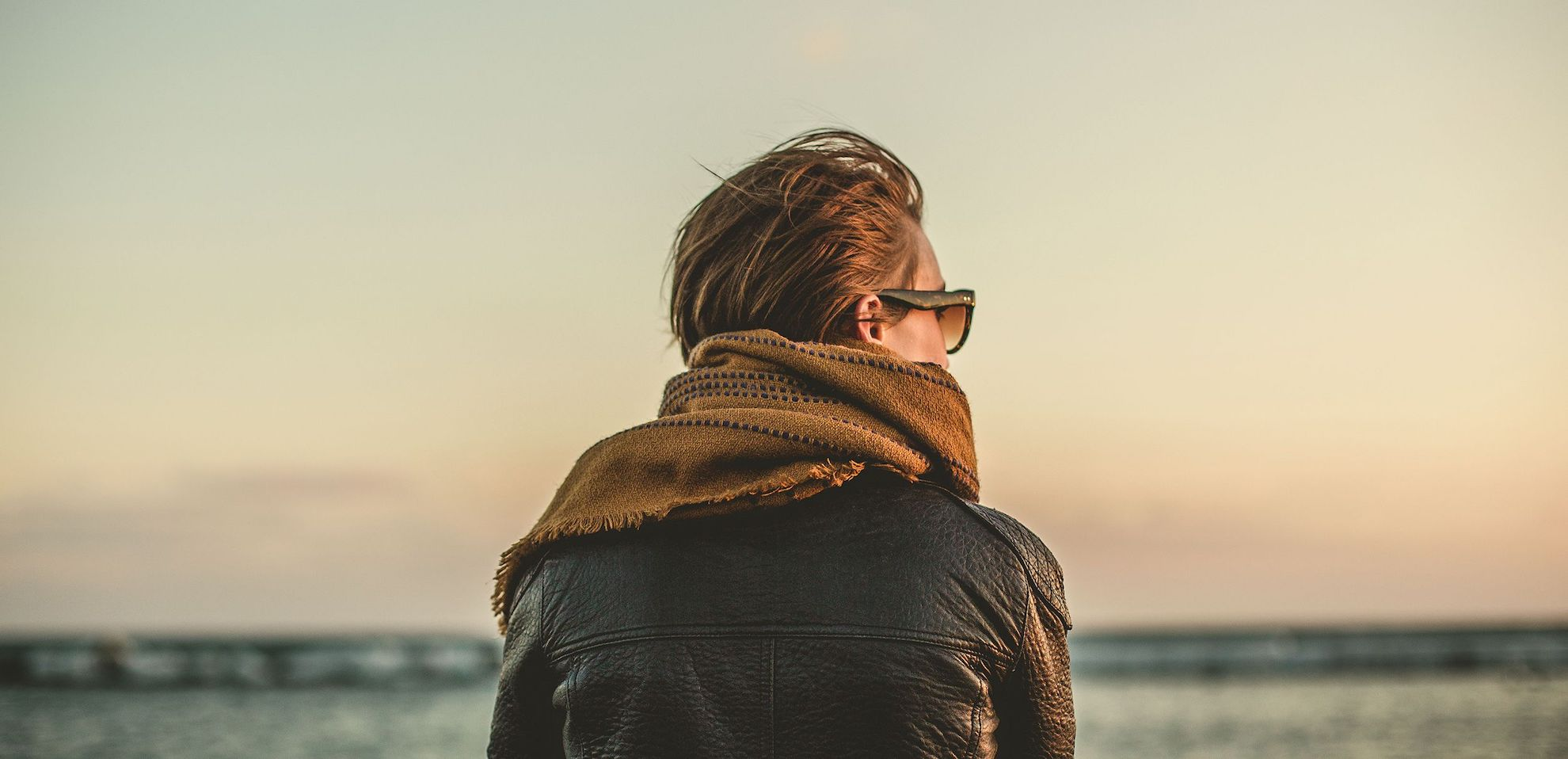 looking into the distance, sunglasses, scarf, leather jacket