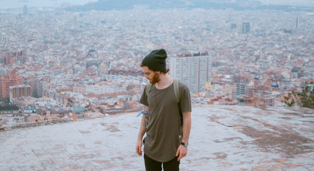 man, rooftop, green beanie, looking down, barcelona, spain, confidence, watch