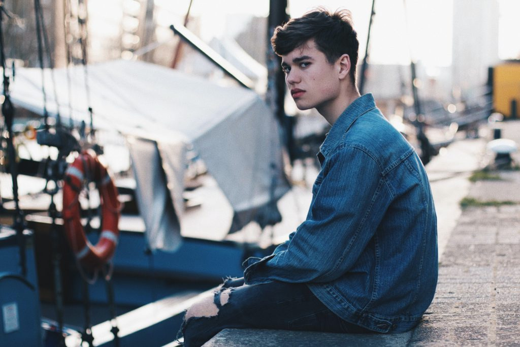 angry teenager, sitting on a dock, how to deal with anger